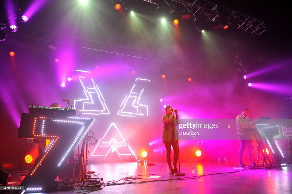 Iain Cook, <a gi-track='captionPersonalityLinkClicked' href=/galleries/search?phrase=Lauren+Mayberry&family=editorial&specificpeople=10104078 ng-click='$event.stopPropagation()'>Lauren Mayberry</a> and Martin Doherty of Chvrches perform on stage at The Forum on March 14, 2014 in London, United Kingdom.