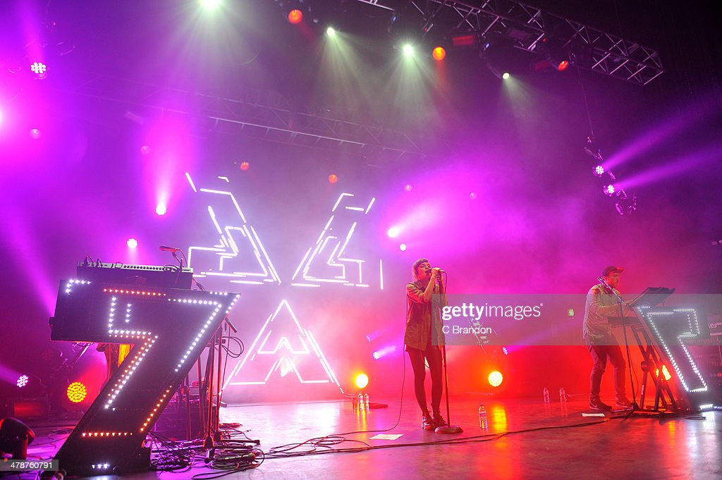 Iain Cook, Lauren Mayberry and Martin Doherty of Chvrches perform on stage at The Forum on March 14, 2014 in London, United Kingdom.