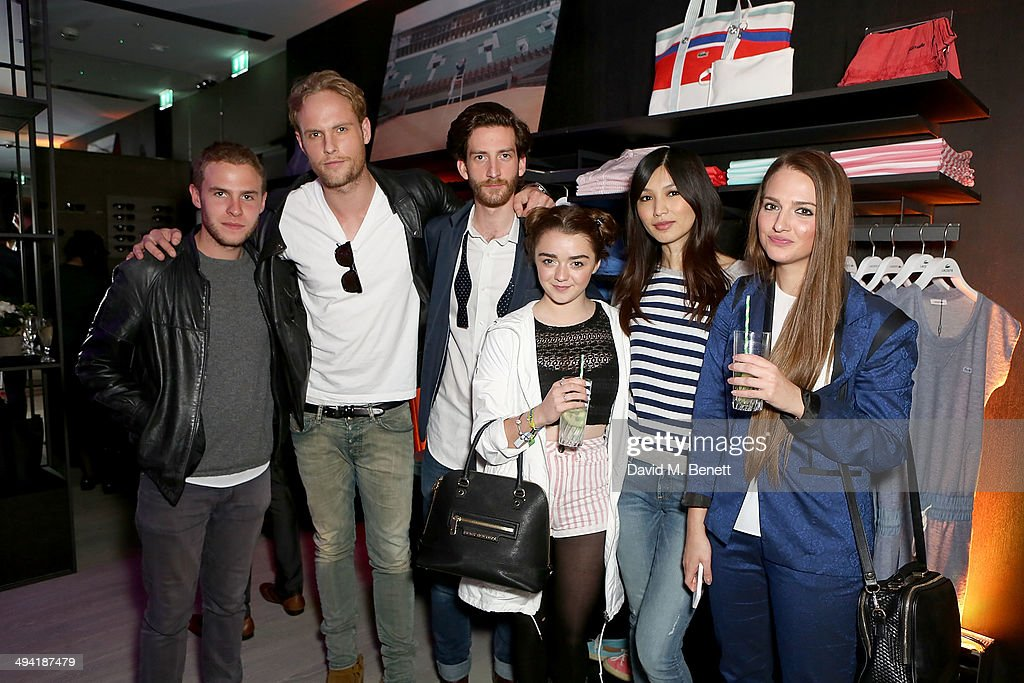 <a gi-track='captionPersonalityLinkClicked' href=/galleries/search?phrase=Iain+De+Caestecker&family=editorial&specificpeople=8832627 ng-click='$event.stopPropagation()'>Iain De Caestecker</a>, Jack Fox, <a gi-track='captionPersonalityLinkClicked' href=/galleries/search?phrase=Maisie+Williams&family=editorial&specificpeople=1766400 ng-click='$event.stopPropagation()'>Maisie Williams</a> and <a gi-track='captionPersonalityLinkClicked' href=/galleries/search?phrase=Gemma+Chan&family=editorial&specificpeople=6928347 ng-click='$event.stopPropagation()'>Gemma Chan</a> attend the Lacoste Store Reopening on May 28, 2014 in London, England.