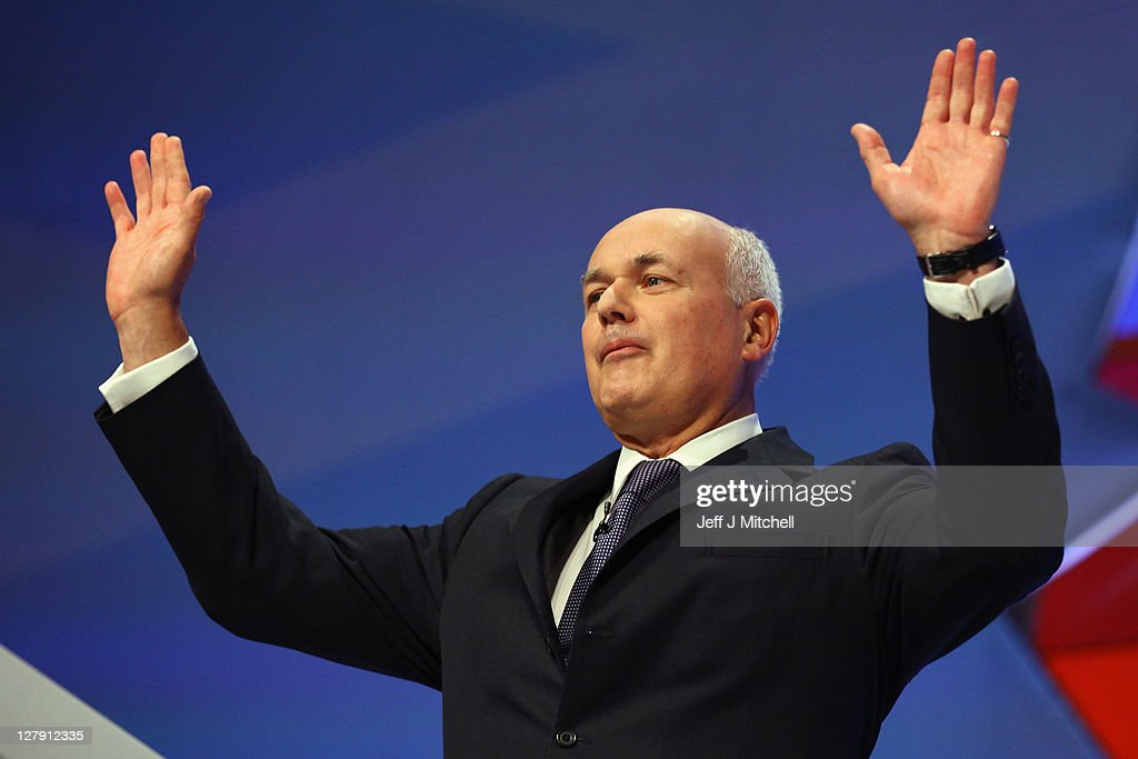 <a gi-track='captionPersonalityLinkClicked' href=/galleries/search?phrase=Iain+Duncan+Smith&family=editorial&specificpeople=159312 ng-click='$event.stopPropagation()'>Iain Duncan Smith</a>, Secretary of State for Work and Pensions takes applause after giving his his speech to delegates at the Conservative Party Conference on October,3 2011 in Manchester, England. Chancellor George Osborne will today announce his plans at the party conference to extend a council tax freeze in England.