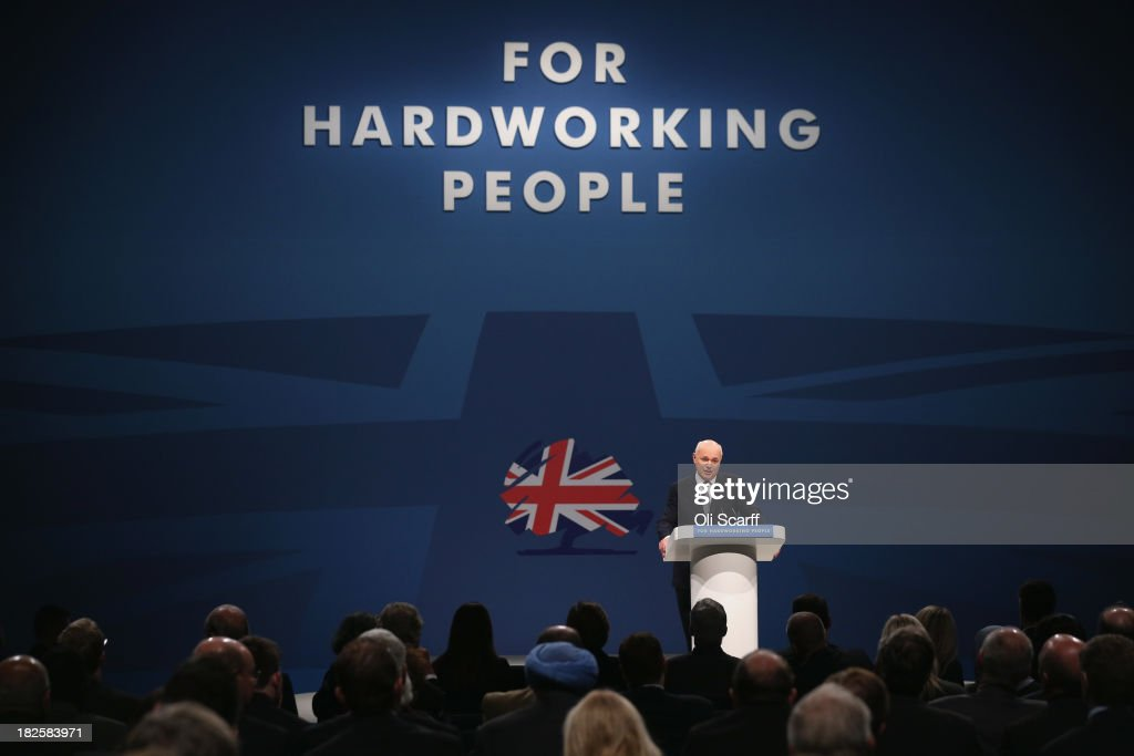 <a gi-track='captionPersonalityLinkClicked' href=/galleries/search?phrase=Iain+Duncan+Smith&family=editorial&specificpeople=159312 ng-click='$event.stopPropagation()'>Iain Duncan Smith</a>, the Secretary of State for Work and Pensions, delivers his speech in the Main Hall of Manchester Central on the third day, and penultimate day, of the Conservative Party Conference on October 1, 2013 in Manchester, England. David Cameron has unveiled a Government pilot scheme for GP surgeries to open from 8am until 8pm seven days, backed by 50 million GBP of funding.