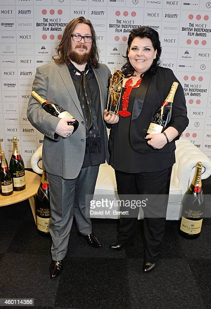 Iain Forsyth and Jane Pollard winners of the Douglas Hickox award for '20000 Days On Earth' pose at The Moet British Independent Film Awards 2014 at...