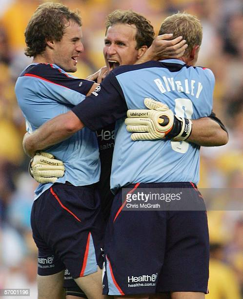 Iain Fyfe Clint Bolton and Matthew Bingley of Sydney FC celebrate victory as the final whistle sounds in the Hyundai ALeague Grand Final between...