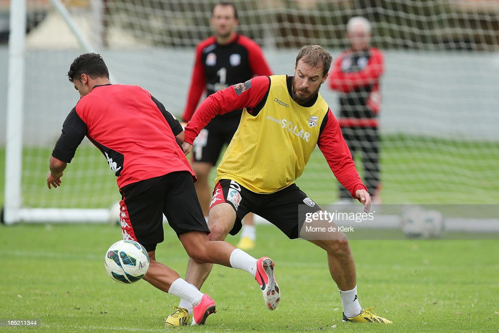Iain Fyfe (R) wins the ball during an Adelaide United A-League training session at the South Australian Sports Institute on April 2, 2013 in Adelaide, Australia.