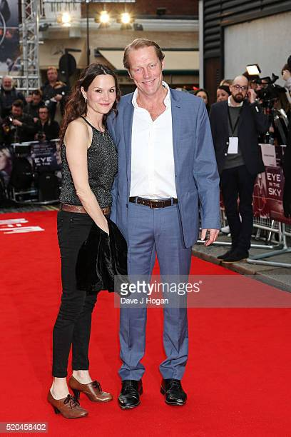 Iain Glen and wife Charlotte Emmerson attend the UK premiere of 'Eye In The Sky' at The Curzon Mayfair on April 11 2016 in London England