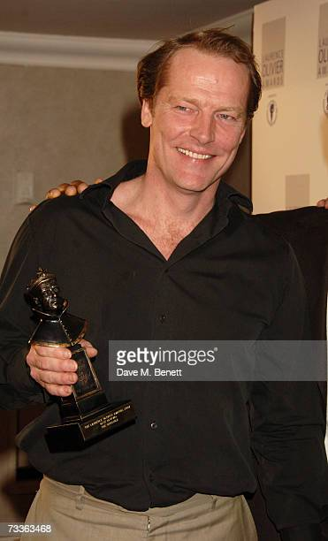 Iain Glen with the Best Revival Award for The Crucible poses backstage with Ray Fearon at the Laurence Olivier Awards held at the Grosvenor House on...