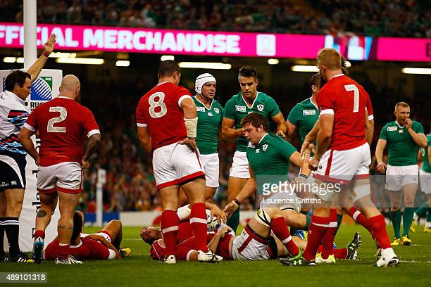 Iain Henderson of Ireland goes over to score his team's second try during the 2015 Rugby World Cup Pool D match between Ireland and Canada at the...