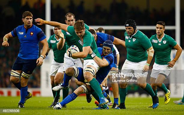 Iain Henderson of Ireland is tackled by Bernard Le Roux of France during the 2015 Rugby World Cup Pool D match between France and Ireland at...