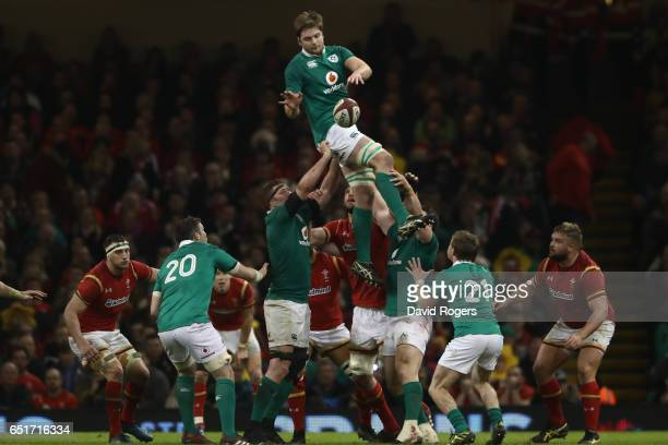 Iain Henderson of Ireland jumps highest in the lineout during the Six Nations match between Wales and Ireland at the Principality Stadium on March 10...