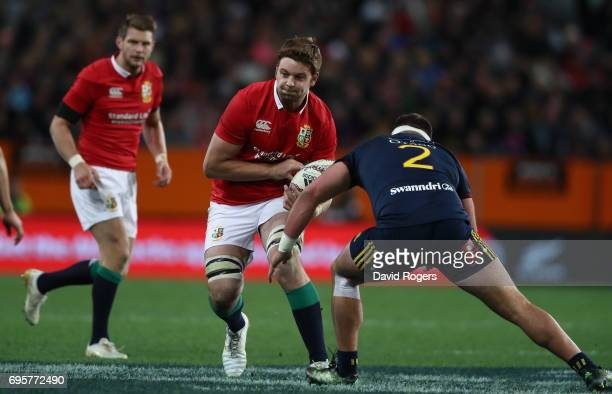 Iain Henderson of the Lions charges upfield during the 2017 British Irish Lions tour match between the Highlanders and the British Irish Lions at...