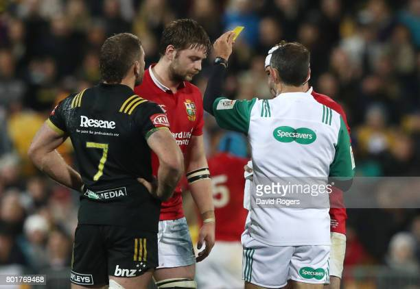 Iain Henderson of the Lions is shown a yellow card by Referee Romain Poite of France during the 2017 British Irish Lions tour match between the...