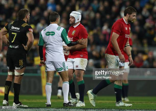 Iain Henderson of the Lions is shown the yellow card as team captain Rory Best talks to referee Roman Poite during the match between the Hurricans...