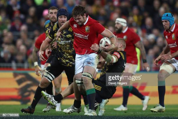 Iain Henderson of the Lions is tackled by Brad Shields of the Hurricanes during the 2017 British Irish Lions tour match between the Hurricanes and...