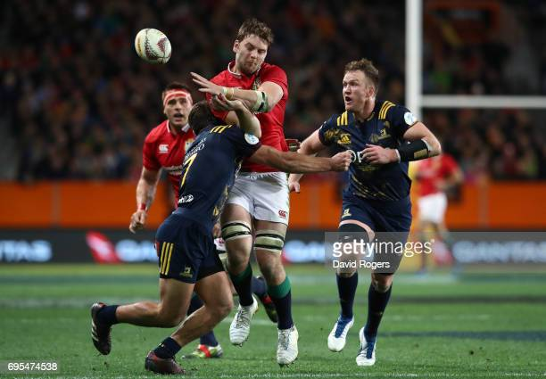 Iain Henderson of the Lions offloads as he is tackled by Dillon Hunt of the Highlanders during the 2017 British Irish Lions tour match between the...