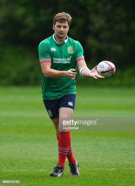 Iain Henderson passes the ball during a British and Irish Lions training session at Vale of Glamorgan on May 15 2017 in Cardiff Wales