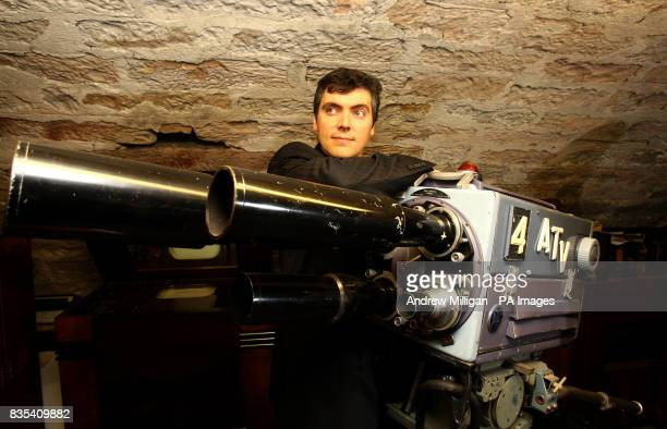 Iain Logie Baird the grandson of John Logie Baird who invented the very first television poses with a Pye Mark 3 camera in Musselburgh where he...