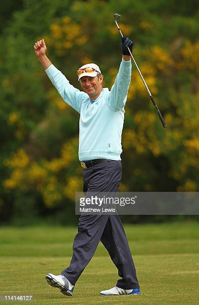 Iain Parker of Royal North Devon Golf Club celebrates his eagle on the first hole after chipping in during the final day of the Senior PGA...