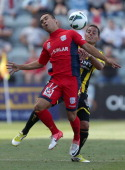 Iain Ramsay of Adelaide under pressure from Leo Bertos of Phoenix during the round 11 ALeague match between Adelaide United and the Wellington...