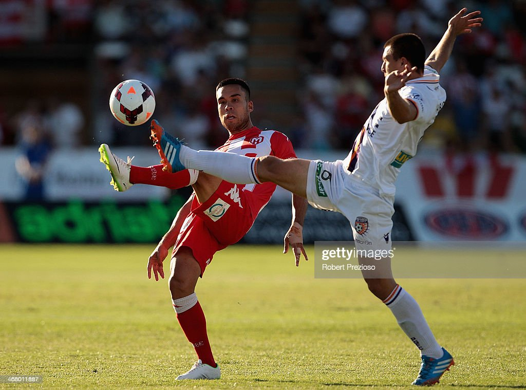 Iain Ramsay of the Heart and Neboisa Marinkovic of the Glory contest the ball during the round 18 ALeague match between Melbourne Heart and Perth...