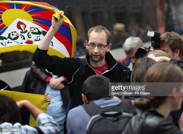 Iain Thom of Students for a Free Tibet who was arrested after unfurling a Free Tibet banner near Beijing's Olympic Stadium arrives at Waverley...