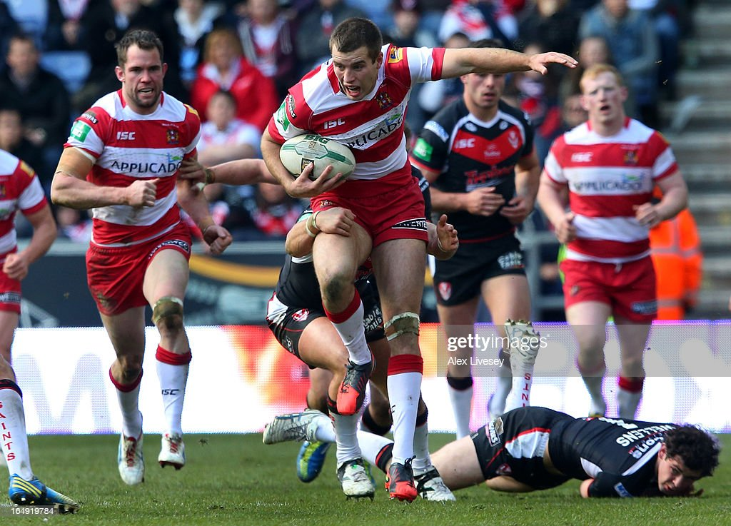 Iain Thornley of Wigan Warriors beats a challenge from <a gi-track='captionPersonalityLinkClicked' href=/galleries/search?phrase=Paul+Wellens&family=editorial&specificpeople=240689 ng-click='$event.stopPropagation()'>Paul Wellens</a> of St Helens during the Super League match between Wigan Warriors and St Helens at DW Stadium on March 29, 2013 in Wigan, England.