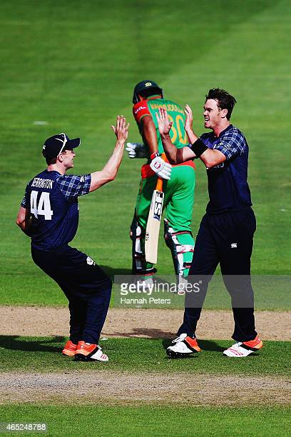 Iain Wardlaw of Scotland celebrates the wicket of Mohammad Mahmudullah of Bangladesh during the 2015 ICC Cricket World Cup match between Bangladesh...
