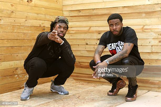 Iamsu and Sage the Gemini pose for a portrait backstage at The Fader Fort presented by Converse during SXSW on March 12 2014 in Austin Texas