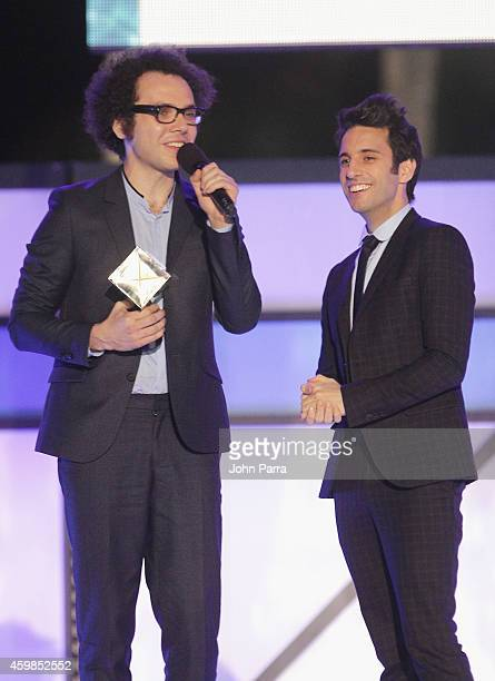 Ian Axel and Chad Vaccarino of A Great Big World accept an award onstage at Logo TV's 2014 NewNowNext Awards at the Kimpton Surfcomber Hotel on...