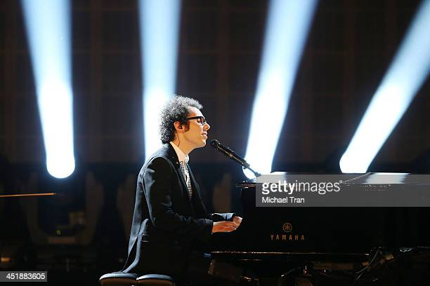 Ian Axel of A Great Big World performs onstage at the 2013 American Music Awards held at Nokia Theatre LA Live on November 24 2013 in Los Angeles...