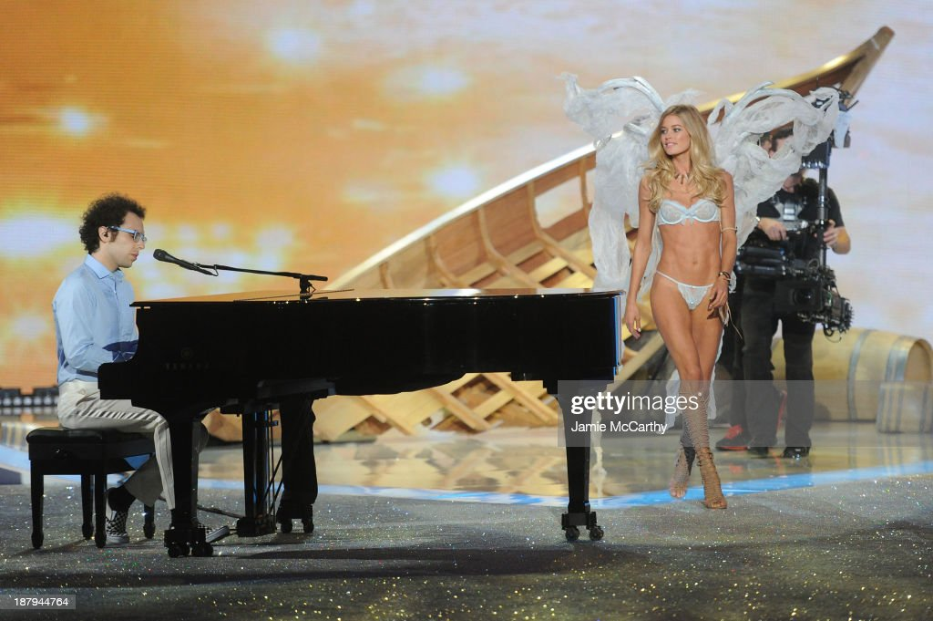 Ian Axel performs as model Doutzen Kroes walks the runway at the 2013 Victoria's Secret Fashion Show at Lexington Avenue Armory on November 13, 2013 in New York City.