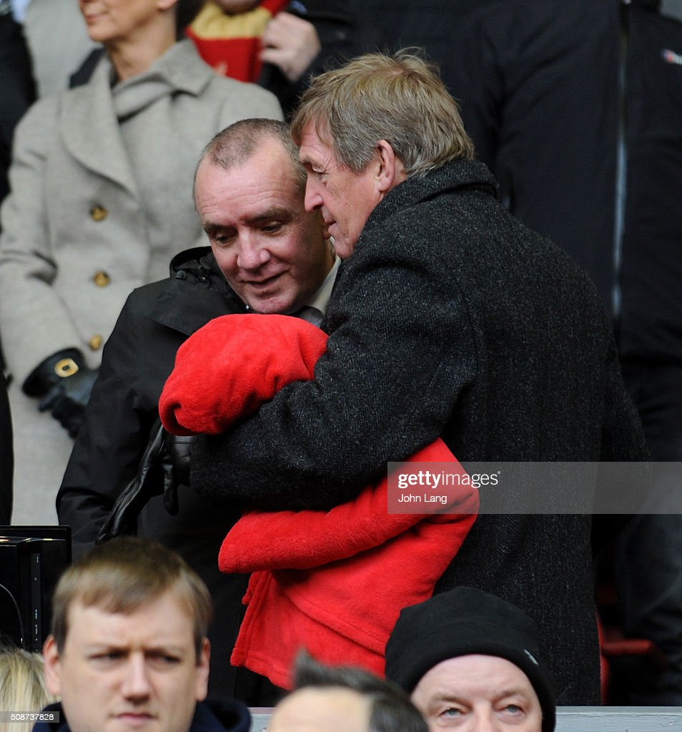 Ian Ayre Chief Executive of Liverpool and Kenny Dalglish share a hug and a chat before the Barclays Premier League match between Liverpool and Sunderland at Anfield on February 6, 2016 in Liverpool, England.