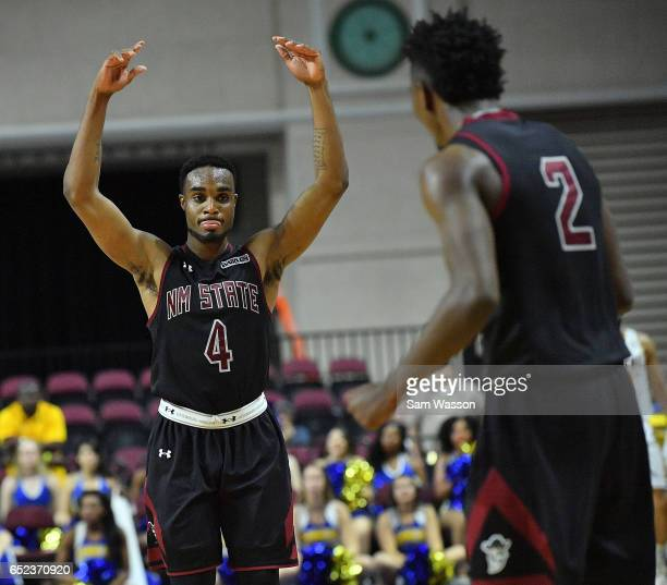 Ian Baker and Braxton Huggins of the New Mexico State Aggies celebrate during the championship game of the Western Athletic Conference Basketball...