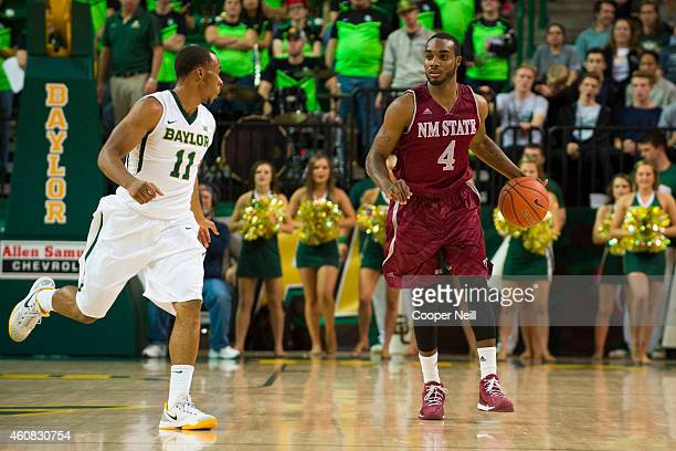 Ian Baker of the New Mexico State Aggies brings the ball up court against the Baylor Bears on December 17 2014 at the Ferrell Center in Waco Texas