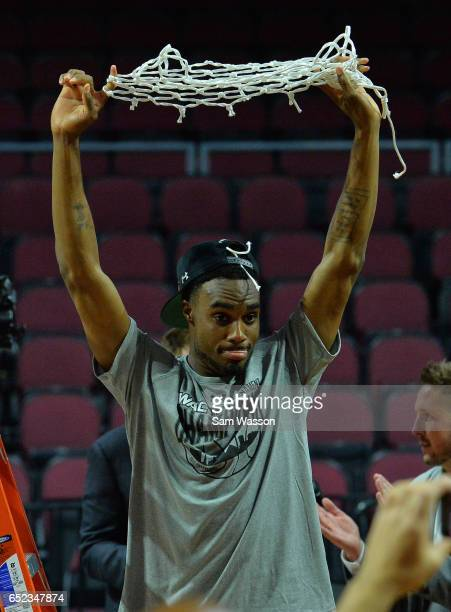 Ian Baker of the New Mexico State Aggies holds up the net following the team's 7060 win over the Cal State Bakersfield Roadrunners to win the...