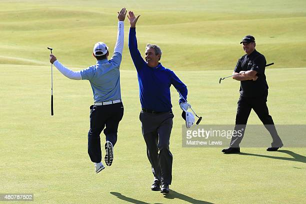 Ian BakerFinch of Australia and Louis Oosthuizen of South Africa 'high five' on the 18th green as Todd Hamilton of the United States looks on during...