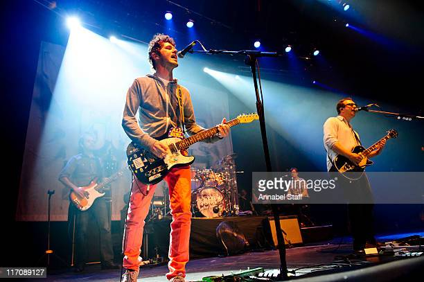 Ian Ball and Ben Ottewell of Gomez perform on stage at The Roundhouse on June 21 2011 in London United Kingdom