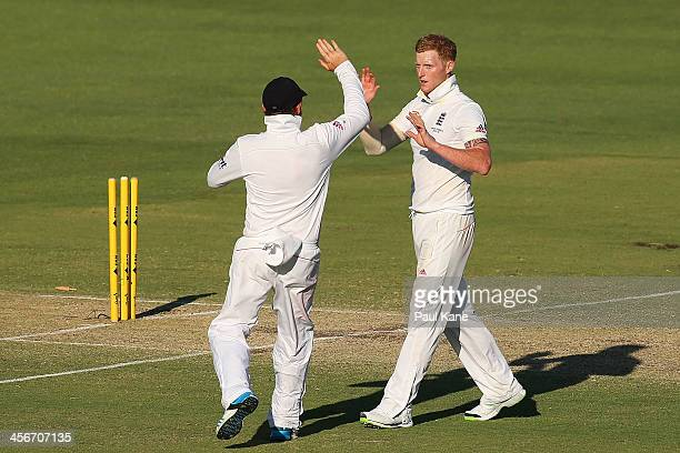Ian Bell and Ben Stokes of England celebrate the wicket of Michael Clarke of Australia during day three of the Third Ashes Test Match between...