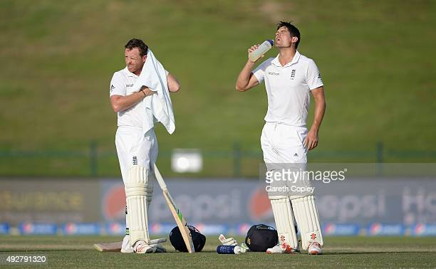 Ian Bell and England captain Alastair Cook cool down during day three of the 1st Test between Pakistan and England at Zayed Cricket Stadium on...