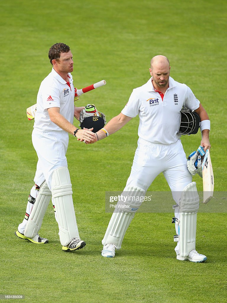 Ian Bell (L) and Matt Prior (R) of England shake hands at the end of play on day five of the First Test match between New Zealand and England at University Oval on March 10, 2013 in Dunedin, New Zealand.