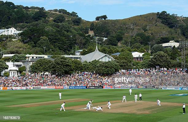 Ian Bell of England catches out Hamish Rutherford of New Zealand from the bowling for Monty Panesar during day three of the second Test match between...