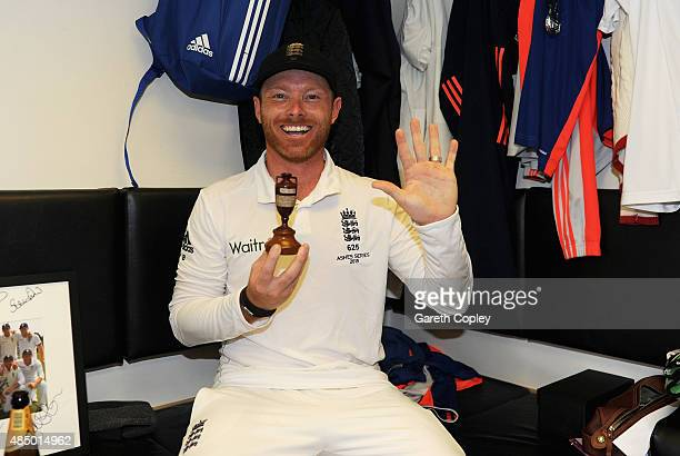 Ian Bell of England celebrates with the ashes urn in the dressing rooms after the 5th Investec Ashes Test match between England and Australia at The...
