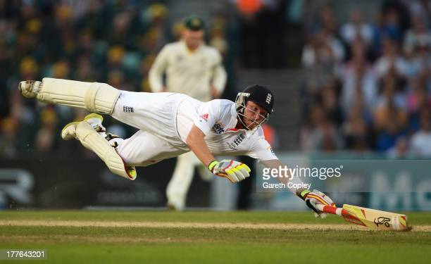 Ian Bell of England dives as he is run out by Mitchell Starc of Australia during day five of the 5th Investec Ashes Test match between England and...