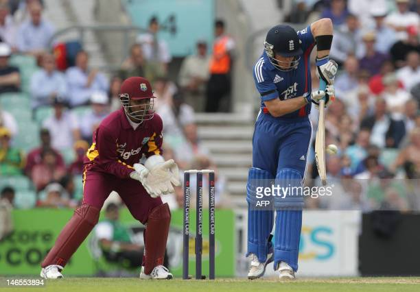 Ian Bell of England hits a four to take him over 50 for the innings during the second oneday international cricket match between England and the West...