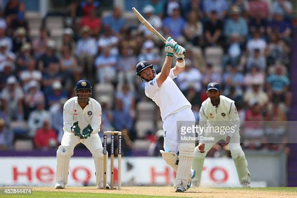 Ian Bell of England hits a straight six off the bowling of Ravindra Jadeja of India as wicketkeeper MS Dhoni looks on to reach his century during day...