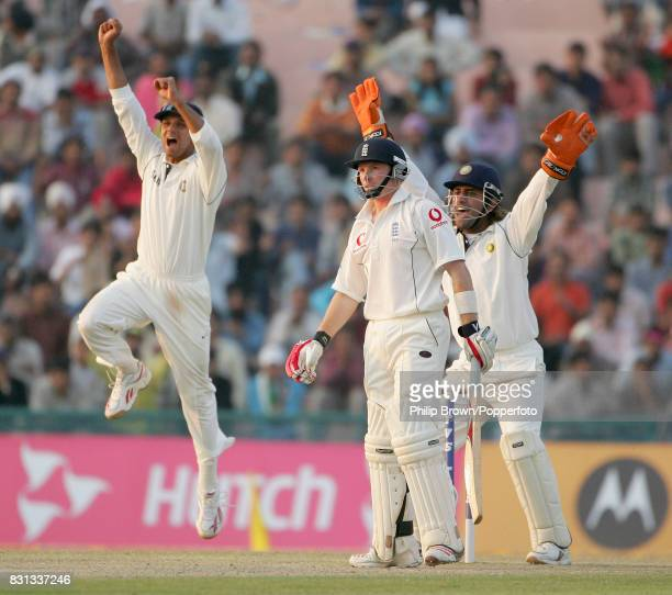 Ian Bell of England is out caught behind by India's wicketkeeper Mahendra Singh Dhoni off the bowling of Anil Kumble for 57 as Rahul Dravid...