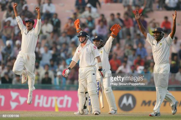 Ian Bell of England is out caught behind by India's wicketkeeper Mahendra Singh Dhoni off the bowling of Anil Kumble for 57 as Rahul Dravid and Wasim...