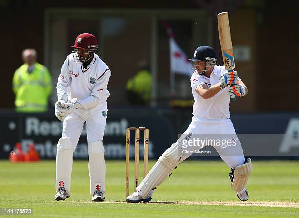 Ian Bell of England Lions in action batting watched by Denesh Ramdin of West Indies during day two of the tour match between England Lions and West...