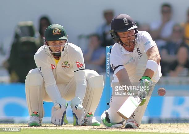 Ian Bell of England plays a sweep shot as Peter Nevill of Australia looks on during day three of the 5th Investec Ashes Test match between England...