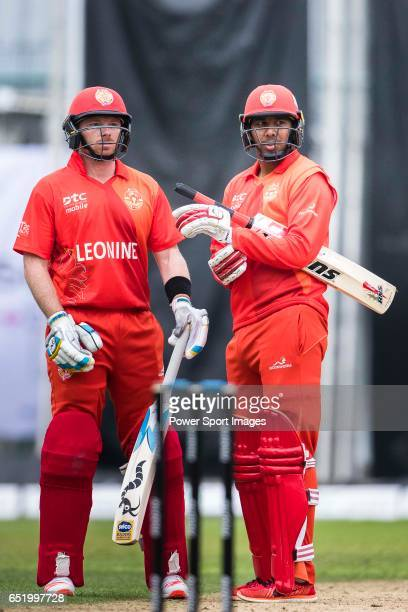 Ian Bell of HKI United and Samuel Badree during the Hong Kong T20 Blitz match between Kowloon Cantons and HKI United at Tin Kwong Road Recreation...