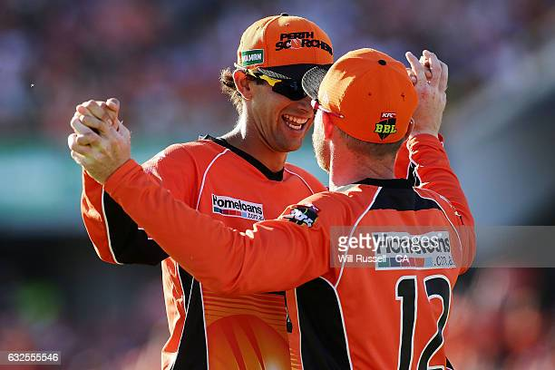Ian Bell of the Scorchers celebrates after taking a catch to dismiss David Hussey of the Stars off the bowling of Andrew Tye of the Scorchers during...
